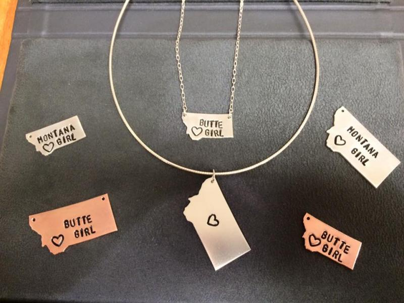Our hand stamped and hand antiqued Butte Girl pendants